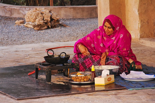 A person sitting at a table with food